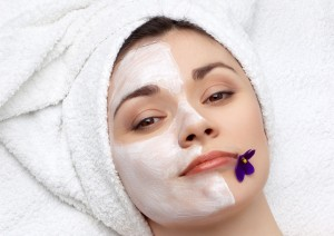 young pretty woman getting facial mask, lot of copyspace